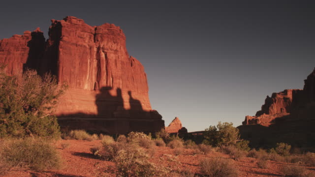 rock face in barren utah landscape, low angle - rock face stock videos & royalty-free footage
