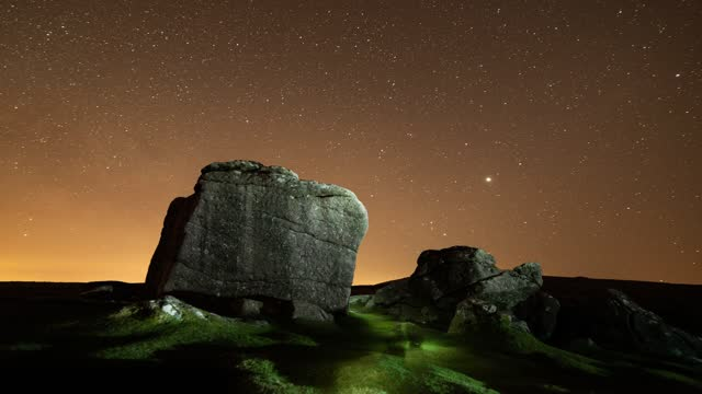 rock formation is illuminated under a starry night sky on september 06 2019, in dartmoor, united kingdom. - solitude stock videos & royalty-free footage