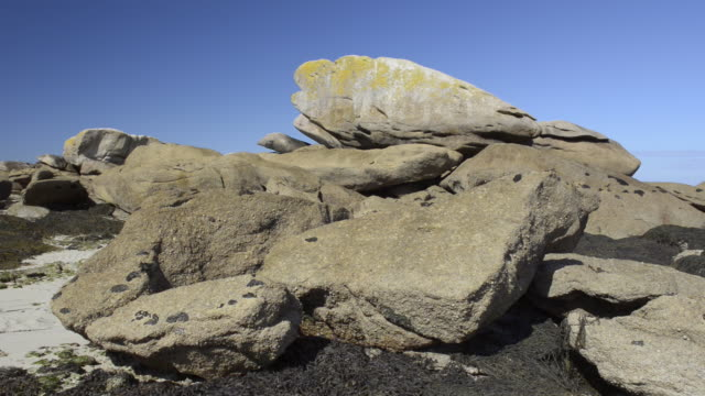 rock formation on beach at low tide - low tide stock videos & royalty-free footage