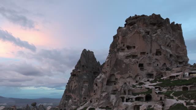 rock formation uchisar castle - rock hoodoo stock videos & royalty-free footage