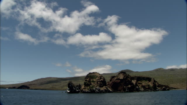 rock formations dot the shoreline of the galapagos islands. - galapagos islands stock videos & royalty-free footage