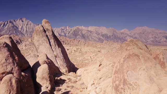 Rock Formations in Alabama Hills with Mt Whitney in Background