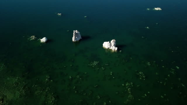 Rock Formations in Deep Emerald Green Lake
