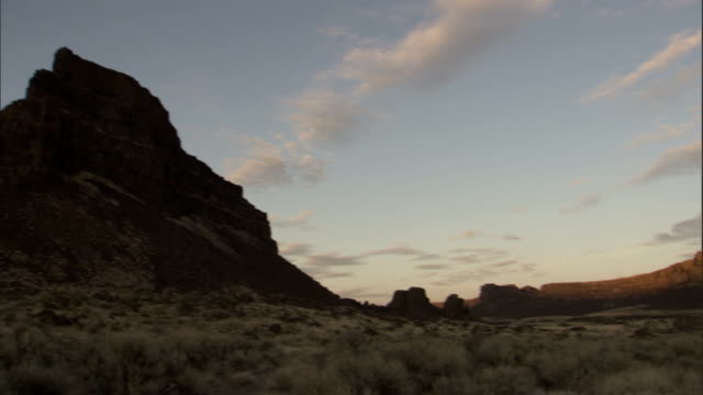 Rock formations in the Scablands rise high above the valley floor. Available in HD.