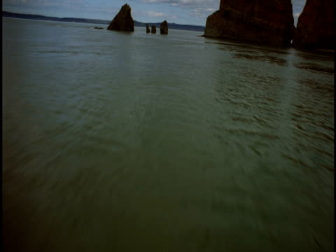 Rock formations jut from the Bay of Fundy.