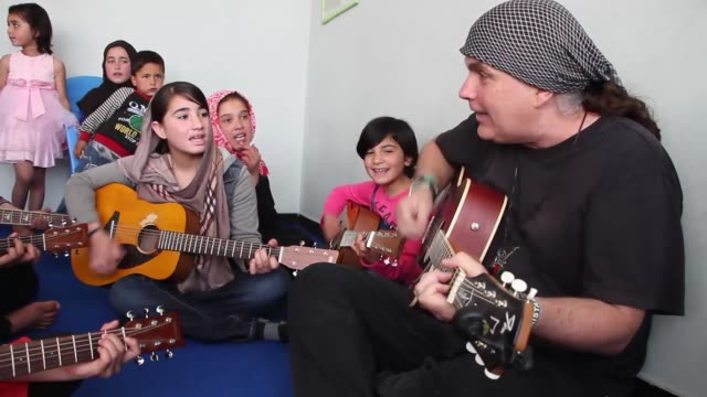rock guitarist lanny cordola practices a song with children at the miraculous love kids music school, in kabul, afghanistan on april 22, 2017. music... - kabul stock videos & royalty-free footage