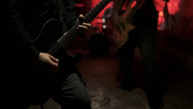 ms rock guitarist on a concert stage - heavy metal stock videos & royalty-free footage