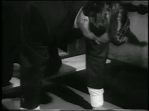 rock hudson putting handprints in cement in front of grauman's chinese theater / hollywood - 30代の男性だけ点の映像素材/bロール