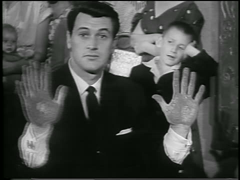 vidéos et rushes de rock hudson showing cement covered hands to camera / hollywood / newsreel - 1956