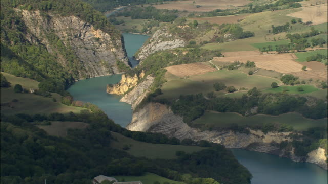 vidéos et rushes de aerial ws rock outcrop along river drac in maritime alpes / rhone-alpes, france - outcrop