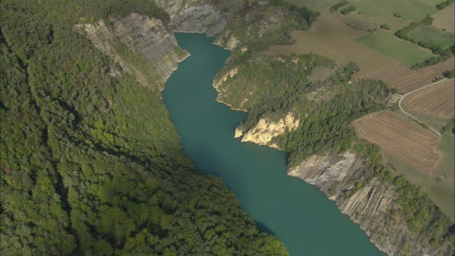 aerial ws rock outcrop along river drac in maritime alpes / rhone-alpes, france - outcrop stock videos and b-roll footage