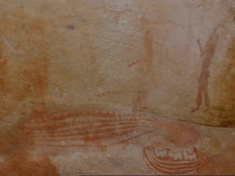 vidéos et rushes de rock painting: men and boat, namaqualand, south africa - grès