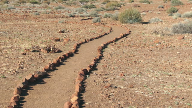 stockvideo's en b-roll-footage met ms tu rock pathway at mountainous landscape / darmaland, kunene, namibia - wiese