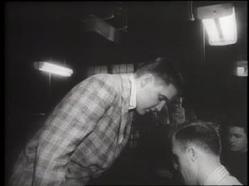 rock singer elvis presley changes from street clothes to army issue as he enters the military in 1958. - armé bildbanksvideor och videomaterial från bakom kulisserna