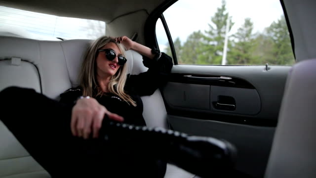 rock star sitting in backseat of limo - stereotypically upper class stock videos & royalty-free footage