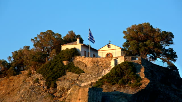 rock with agios ioannis church on skopelos island at sunset - mamma mia stock videos and b-roll footage