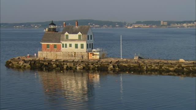 LOW AERIAL, WS, Rockalnd Harbor Breakwater Light, Maine, USA