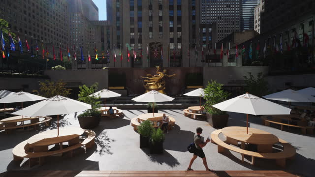 rockefeller center ice rink becomes outdoor restaurant during the pandemic of covid-19 during the summer season on july 14 in midtown manhattan, new... - sunbeam stock videos & royalty-free footage