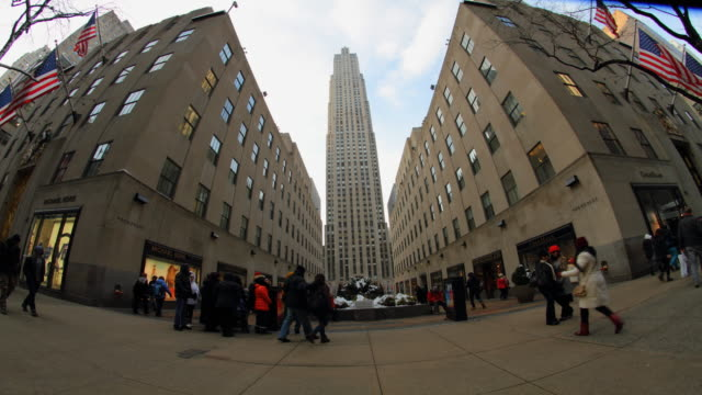 rockefeller center in new york city with pedestrians in new york city time lapse. - rockefeller center video stock e b–roll