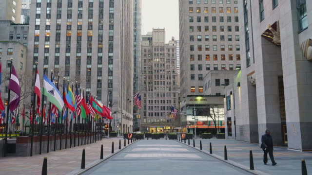 rockefeller center, one of the most popular and crowded tourist destinations is now abandoned due to the covid-19 outbreak, and the famous ice rink... - pole stock videos & royalty-free footage