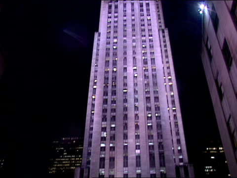 rockefeller plaza highrise office building td ls giant norway spruce w/ lights on people w/ umbrellas in shadows holiday decorations lights angel... - rockefeller center stock videos & royalty-free footage