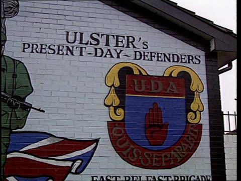 rocket attack; nothern ireland: rocket attack; lib n. ireland: loyalist paramilitary murals - loyalty stock videos & royalty-free footage
