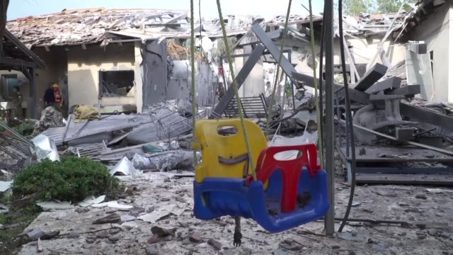 a rocket fired from the gaza strip hits a house in the moshav of mishemeret near the town of kfar saba north of tel aviv wounding seven israelis and... - cut video transition stock videos and b-roll footage