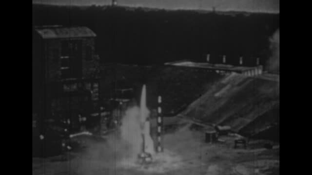 v2 rocket in flight after launching / v2 rocket lifts off successfully / rocket lifts off but veers off course and twists in air / two shots of... - stapellauf stock-videos und b-roll-filmmaterial