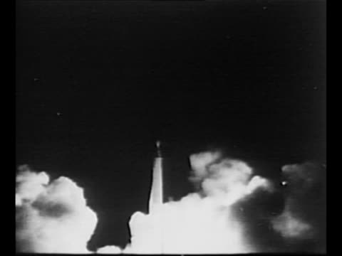 rocket juno ii's engines ignite and pioneer 4 probe lifts off from launch pad at cape canaveral smoke billows as rocket moves into sky / rear shot... - 1950 1959 stock videos & royalty-free footage