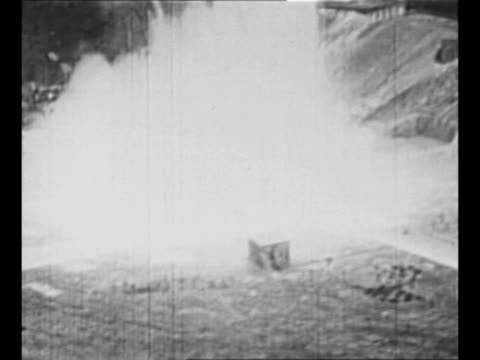 ws v2 rocket on pad in germany shoots out fire falls over and explodes before test launch at peenemunde germany in 1940s / two allied b29 flying... - nazi germany stock videos and b-roll footage