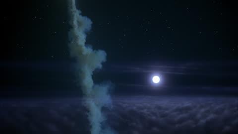 vidéos et rushes de ws rocket shooting through clouds at night, full moon - infini
