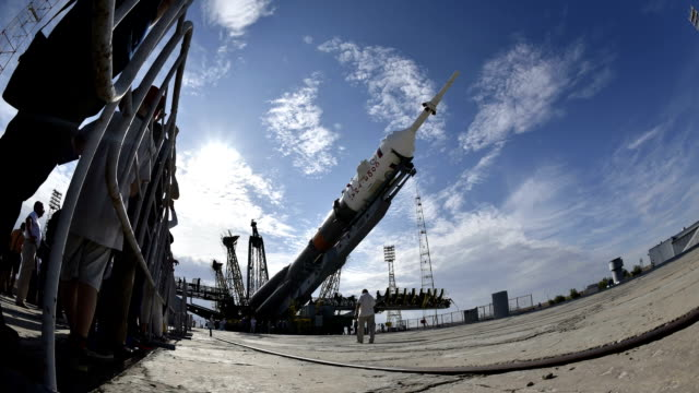 a rocket to carry a russian soyuz spacecraft was installed at a launch pad at the baikonur cosmodrome in kazakhstan on july 20 2015 japanese... - stapellauf stock-videos und b-roll-filmmaterial