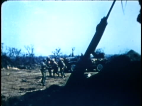 rocket truck firing streams of rockets soldiers dive for cover just before japanese bomb expodes near camera wounded soldiers carried on stretchers... - schlacht um iwojima stock-videos und b-roll-filmmaterial