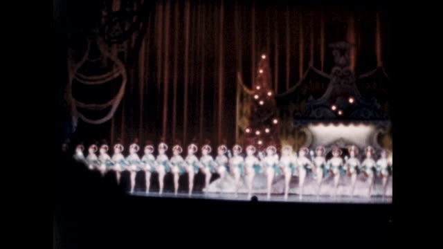 rockettes performance at the radio city christmas spectacular a long line of dancers do the cancan on stage - radio city music hall stock videos & royalty-free footage