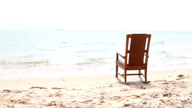 rocking chair on the beach. - rocking chair stock videos and b-roll footage