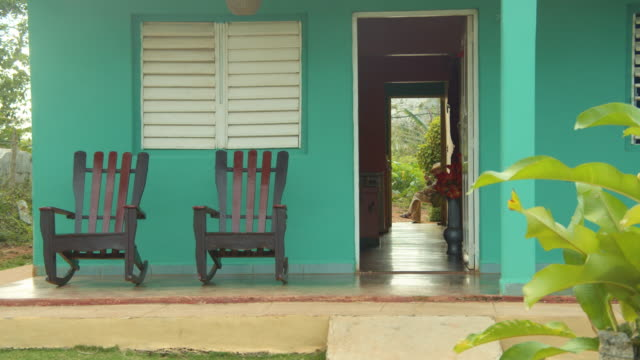 rocking chairs in front of a green house in vinales, cuba - front doorway stock videos & royalty-free footage