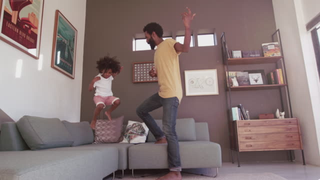 rocking out in the living room - dancing stock videos & royalty-free footage