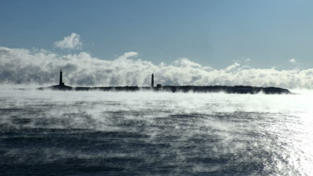 rockport's thacher island lighthouse in arctic sea smoke - rockport massachusetts stock videos & royalty-free footage