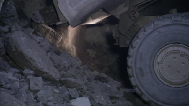 rocks and dust spill out of a mining vehicle. - lead stock videos & royalty-free footage
