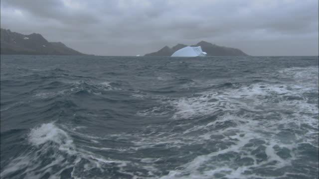 MS, TD, Rocks and iceberg seen from ocean, South Georgia Island