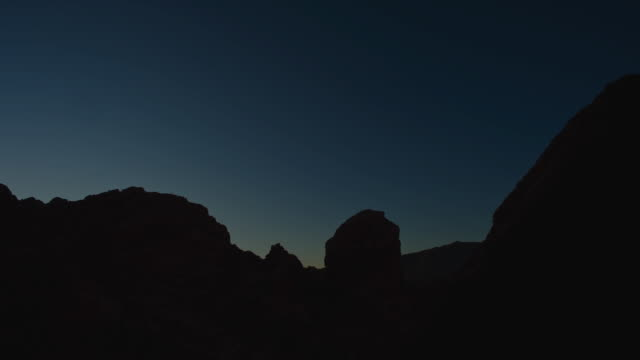 t/l ms la rocks and sky in red rock canyon, night to day, nevada, usa - rock formation stock videos & royalty-free footage