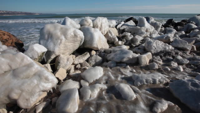 rocks covered by ice on a beach in wintertime - bulgarien stock-videos und b-roll-filmmaterial