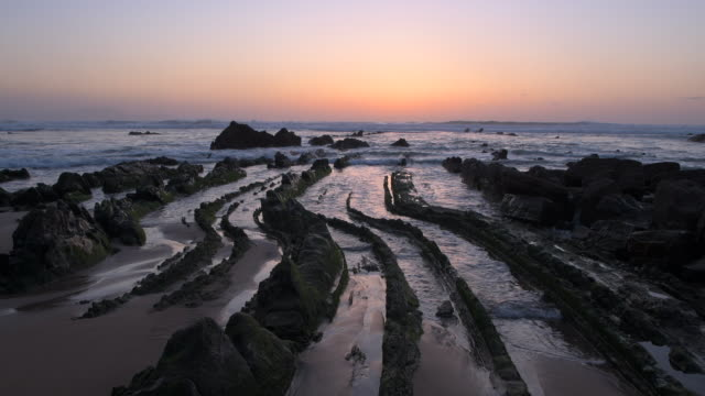 Rocks of flysch at Barrika beach at sunset. Spain, Bay of Biscay, Pais Vasco, Euskadi, Basque Country.