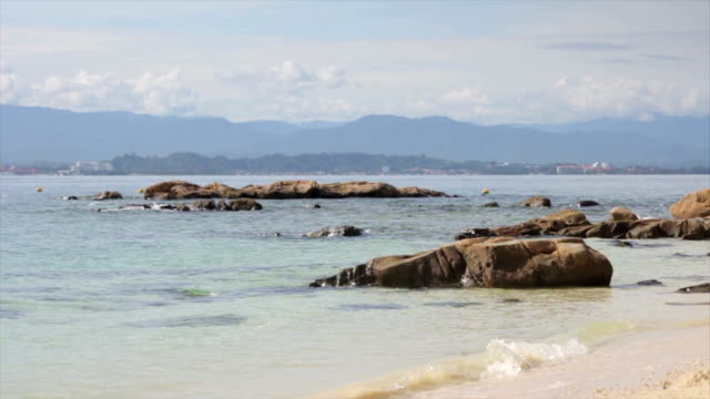 rocks on a beach in borneo - malaysia stock videos & royalty-free footage