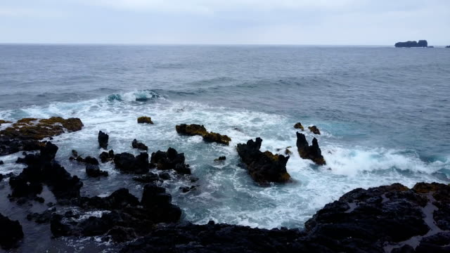 Rocks Sticking Out of Water on Edge of Maui Island