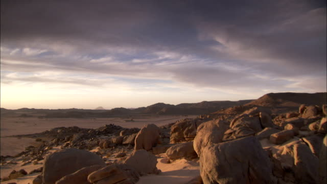 Rocks stretching across desert landscape Available in HD.