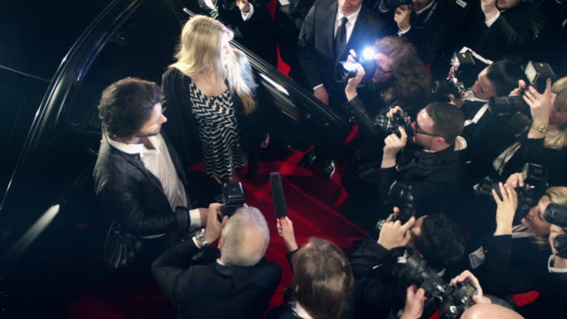 vidéos et rushes de rockstar on red carpet - millionnaire