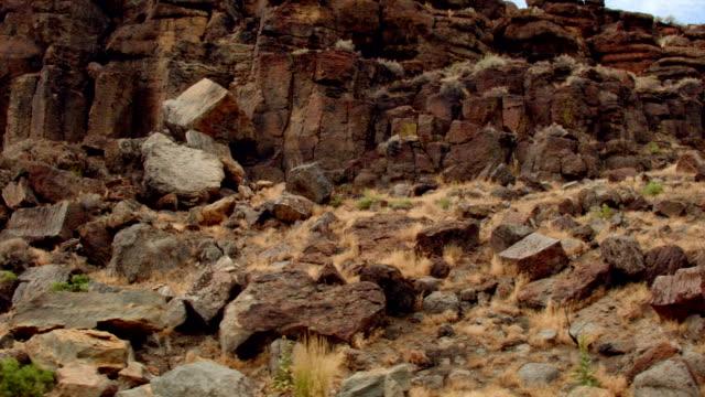 rocky basalt column erosion cliffs broken drive steens mountain oregon 10 - basalt stock videos & royalty-free footage