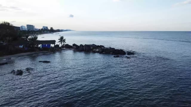 rocky beach with little hut in phu quoc island (vietnam) in the early morning [drone aerial footage] - moving shot - vietnam meridionale video stock e b–roll