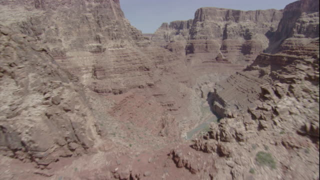 Rocky buttes surround the Grand Canyon. Available in HD.